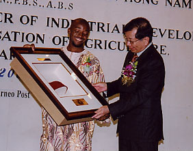 The chairman of Codewit Global network, Mr. Anthony Claret Onwutalobi (left) and the Deputy Chief Minister of Sarawak, George Chan (right) during the opening ceremony of the first African Convention (involving 15 African countries) held by African Students Association of INTI College Sarawak at Mary'ek hall, Kuching, Sarawak, Malaysia in 2005.